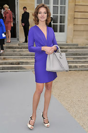 Natalia was lovely in purple at the Dior show. She accessorized the look with peep-toe pumps complete with strappy detailing.