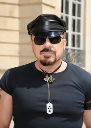 Peter topped off his biker look with a silver dog tag necklace and a leather cap.