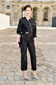 Laetitia Casta kept it fuss-free yet chic in a shiny black jumpsuit by Christian Dior Couture during the label's fashion show.