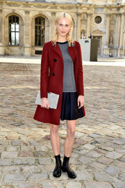 Aymeline Valade cozied up in a sweet red coat for the Christian Dior fashion show.