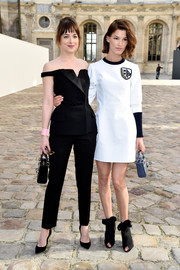 Hanneli Mustaparta attended the Christian Dior fashion show wearing a preppy white sweater dress from the label.