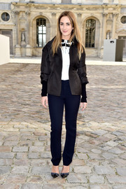 Alexia Niedzielski went for sporty sophistication in a fitted black jacket during the Christian Dior fashion show.