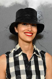 Caroline Issa punctuated her monochrome look with a red lip.