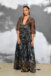 Gal Gadot was a boho beauty in an embroidered maxi dress by Dior during the brand's Couture Fall 2019 show.