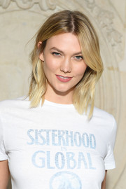 Karlie Kloss sported a center-parted layered cut at the Dior Fall 2019 show.