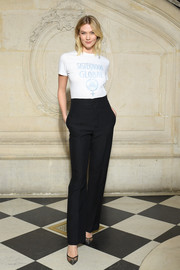 Karlie Kloss kept it casual in a white Dior tee during the brand's Fall 2019 show.