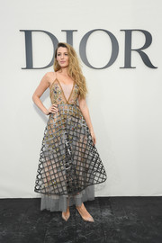 Blake Lively rounded out her look with a pair of studded PVC pumps by Christian Louboutin.