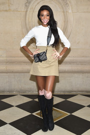 Winnie Harlow completed her ensemble with a mini shoulder bag by Dior.