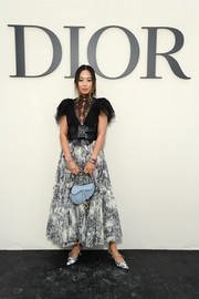 Aimee Song paired her blouse with a printed maxi skirt.