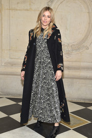 Sienna Miller finished off her dress with a floral-embroidered coat.
