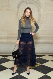 For her bag, Dylan Penn chose this chic chain-strap number, also by Dior.