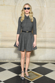 Jennifer Lawrence looked cute in a gray fit-and-flare mini dress by Dior during the brand's Fall 2019 show.