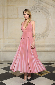 Cara Delevingne punctuated her pink look with nude lace-up pumps by Dior.