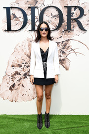 Nicole Warne layered a crisp white blazer over a silk cami and a mini skirt for the Christian Dior Couture show.