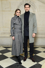 Olivia Palermo looked impeccable in a gray Dior shirtdress with scarf detail during the brand's Fall 2018 show.