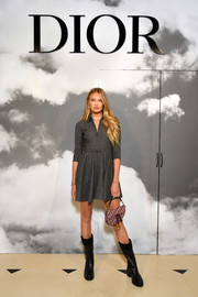 Romee Strijd showed off her long legs in a gray mini dress at the Dior Couture Fall 2019 show.