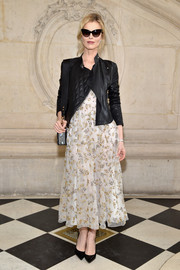 Eva Herzigova balanced out her edgy outerwear with a delicate floral-embroidered dress.
