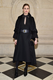 Olivia Palermo looked perfectly polished in a black keyhole-cutout dress by Dior while attending the label's fashion show.