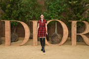 Olivia Palermo kept it youthful in a red and black gingham dress by Dior during the brand's Spring 2020 show.