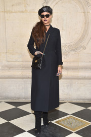 Rihanna looked uncharacteristically understated in this black Dior wool coat during the label's fashion show.