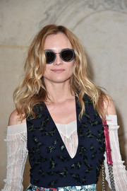Diane Kruger wore her hair in tousled waves at the Dior fashion show.