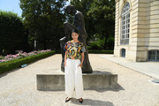 Caroline Issa paired her top with white wide-leg trousers.