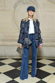Helena Bordon was hippie-glam in a fringed tweed jacket by Dior at the brand's Fall 2018 show.