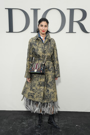 Caroline Issa injected some color with a striped shoulder bag by Dior.