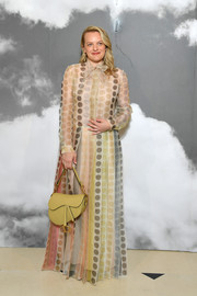 Elisabeth Moss looked delightful in a pastel polka-dot gown at the Dior Couture Fall 2019 show.