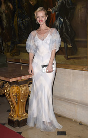 Eva Herzigova polished off her look with a metallic silver clutch by Dior.