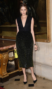 Elena Perminova sparkled in a Dior Couture LBD with a beaded skirt during the label's Cruise show.