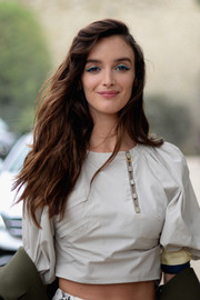 Charlotte Le Bon got playful with her beauty look, lining her eyes with a popping blue hue.