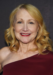 Patricia Clarkson attended the Christian Siriano fashion show wearing her hair in bouncy curls.