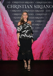Alicia Silverstone was trendy and feminine in a cold-shoulder lace peplum top by Christian Siriano at the 'Dresses to Dream About' book launch.