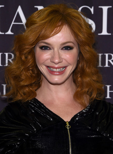 Christina Hendricks attended the 'Dresses to Dream About' book release wearing high-volume curls with side-swept bangs.