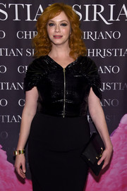 Christina Hendricks accessorized with an elegant black patent and suede clutch at the 'Dresses to Dream About' book release.