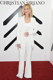 Meg Ryan brightened up the red carpet with her all-white jacket, pants, and blouse combo at the Christian Siriano fashion show.