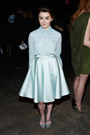 Maisie Williams looked modest at the Christian Siriano fashion show in a pastel blue polka-dot blouse buttoned all the way up to the neck.
