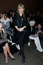 Tennessee Thomas toughened up her LBD with a black suede biker jacket when she attended the Christian Siriano fashion show.