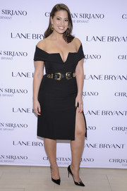 Ashley Graham flaunted major cleavage in a plunging black off-the-shoulder gown while attending the Christian Siriano x Lane Bryant event.