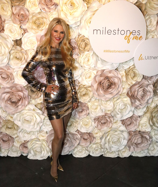 Christie Brinkley glitzed up in a gold and silver sequined dress for her 65th birthday party.
