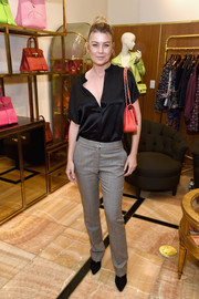 Ellen Pompeo was casual-chic in a black satin blouse at the Christie's x What Goes Around Comes Around 25th anniversary auction preview.