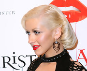 Christina showed off a creepy pair of spider earrings at the release of her new album 'Bionic'.