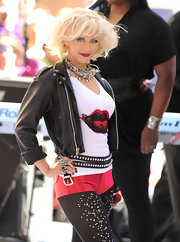 Xtina is back and bolder than ever! The singer made her 'Today Show' appearance in a over the top embellished ensemble, including a studded double-banded belt.