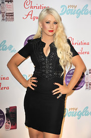 Christina Aguilera wore her platinum blonde hair in long curls for the launch of her new fragrance 'Royal Desire.'