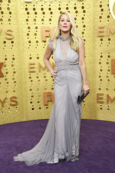 Christina Applegate Evening Dress [hair,clothing,dress,gown,red carpet,carpet,fashion model,hairstyle,flooring,lady,arrivals,christina applegate,emmy awards,microsoft theater,los angeles,california]
