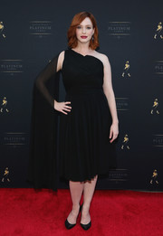 Christina Hendricks looked dramatic in a navy one-shoulder dress during the launch of Johnnie Walker Platinum.