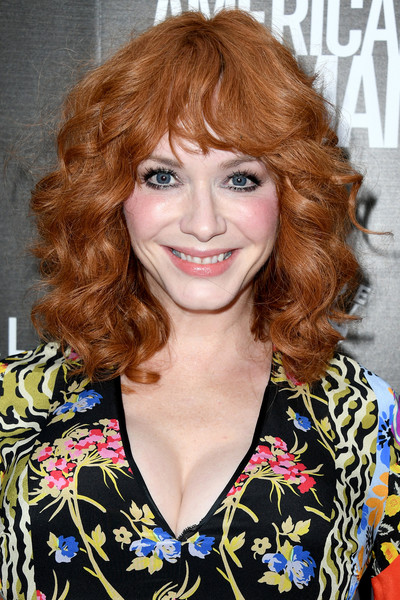 Christina Hendricks Medium Curls with Bangs [hair,face,hairstyle,bangs,eyebrow,beauty,brown hair,hair coloring,chin,blond,arrivals,american woman,christina hendricks,of roadside attraction,premiere of roadside attraction,arclight hollywood,california]