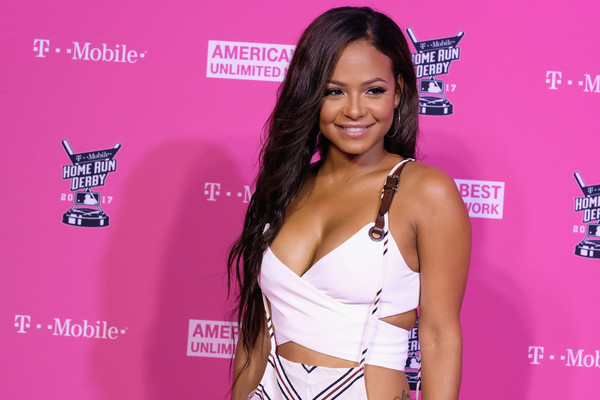 Christina Milian Feathered Flip [pink,eyelash,premiere,long hair,carpet,red carpet,model,brown hair,black hair,christina milian,t-mobile presents derby,miami beach,florida,after dark,faena forum]