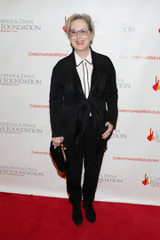 Meryl Streep teamed a black cardigan with a pair of slacks for the 'Magical Evening' event.